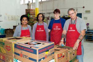 volunteers in red aprons